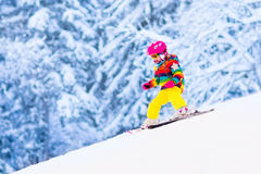 Little girl skiing in the mountains Royalty Free Stock Photos