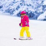 Little girl skiing in the mountains Royalty Free Stock Photo