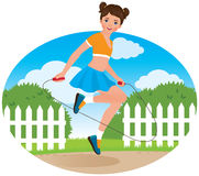 Little girl with a skipping rope Stock Photography