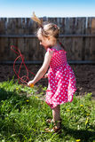Little girl with a skipping-rope Royalty Free Stock Image
