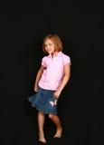 Little girl in skirt Stock Image