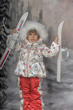 Little girl with skis in hand Royalty Free Stock Photo