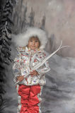 Little girl with skis in hand Royalty Free Stock Images