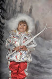 Little girl with skis in hand Stock Photos