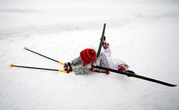Fallen little skier Royalty Free Stock Photos