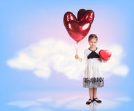 Little girl in sky clouds Royalty Free Stock Image