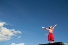 The little girl and the sky Stock Image