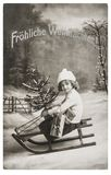 Little girl sled Christmas tree Nostalgic vintage picture royalty free stock image