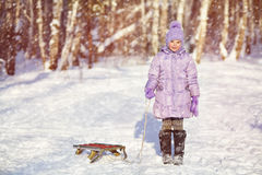 Little girl with sled Stock Images