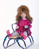 Little girl with sled on white background Stock Photography