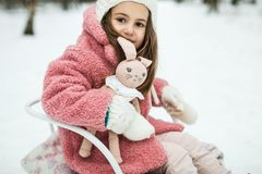 Little girl on sled in the forest royalty free stock images