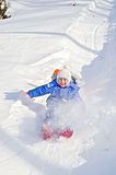 Little girl on a sled in the winter Royalty Free Stock Image