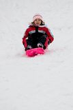 Little girl on sledge Stock Image