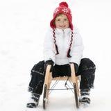 Little girl on sledge Royalty Free Stock Image