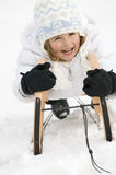 Little girl on sledge Royalty Free Stock Images