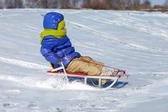 Little girl on sledge Stock Photography