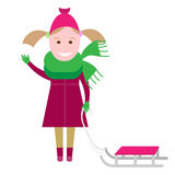 Little girl with a sledge Royalty Free Stock Image