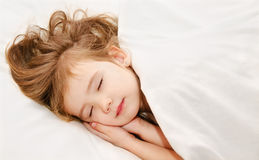 Little girl sleep in the bed. Adorable little girl sleep in the bed Stock Images