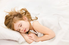 Little girl sleep in the bed Stock Image