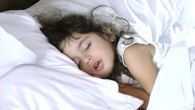 Little girl sleep on bed