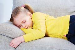 Little girl sleep on sofa in casual Stock Photo