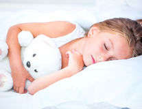 Little girl sleep. With the teddy bear royalty free stock image
