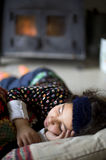 Little girl sleeping. By the stove Stock Images