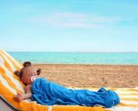 Little girl sleeping on beach Stock Photography