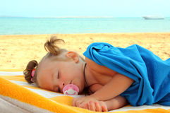 Little girl sleeping on beach Royalty Free Stock Photography