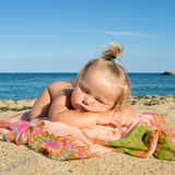 Little girl sleeping on beach Royalty Free Stock Images