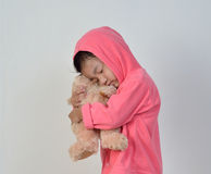 Little girl is sleeping with a bear. Royalty Free Stock Image