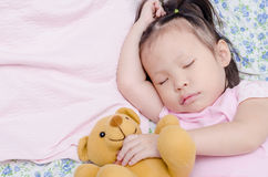Little girl sleeping on bed Stock Images