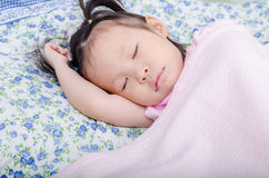 Little girl sleeping on bed. Little Asian girl sleeping on bed Royalty Free Stock Images