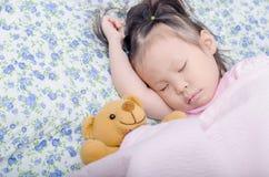 Little girl sleeping on bed Stock Photography