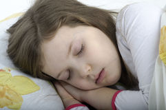 Little girl sleeping in bed Royalty Free Stock Photos