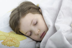 Little girl sleeping in bed Royalty Free Stock Images