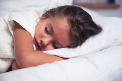 Little girl sleeping in bed Stock Photography