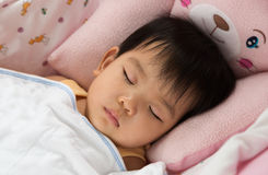 Little girl sleeping in the bed Royalty Free Stock Images