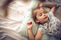 Sweet dream. Kid on bed. stock photography