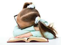 Little girl is sleeping on a book Royalty Free Stock Photo