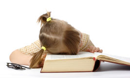 Little girl is sleeping on book, back to school Royalty Free Stock Photos