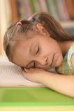 Little girl sleeping on book Royalty Free Stock Image