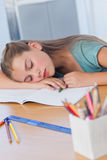 Little girl sleeping on books Royalty Free Stock Photos