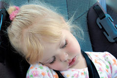 Little girl sleeping in car seat Royalty Free Stock Photos
