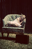 Little girl sleeping in chair Stock Photo