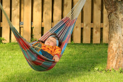 Little girl sleeping in hammock Stock Photos