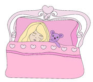 Little girl sleeping with her bear toy Royalty Free Stock Photo