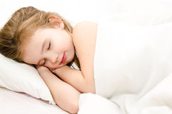 Little girl sleeping in her bed Stock Image