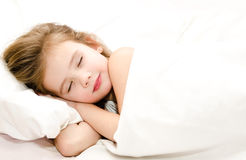 Little girl sleeping in her bed Stock Photos