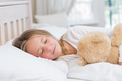 Little girl sleeping in her bed Stock Photography